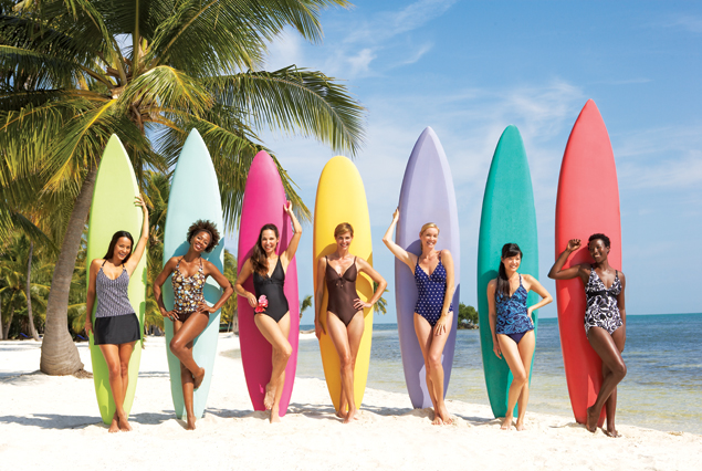 Girls with multi color surfboards